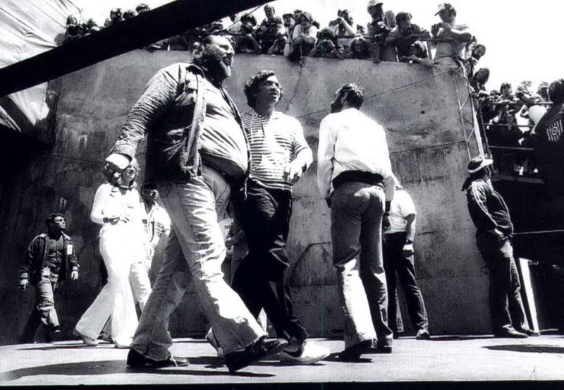 03 1977-07-24_PG_with_Bill_Graham_Richard_Cole_Oakland_Coliseum_by_Michael_Zagaris-01